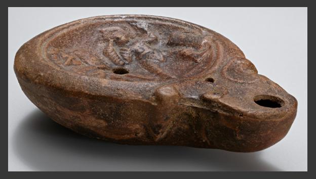 Ancient lamp illustrating gladiators in combat